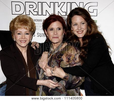 HOLLYWOOD, CALIFORNIA - Tuesday December 7, 2010. Debbie Reynolds, Carrie Fisher, and Joely Fisher at the Los Angeles premiere of