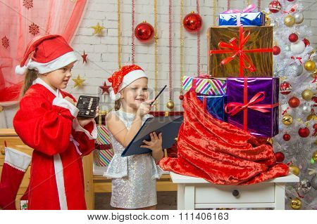Santa And Helper Happily Recount Gifts In A Bag And Checked Against The List