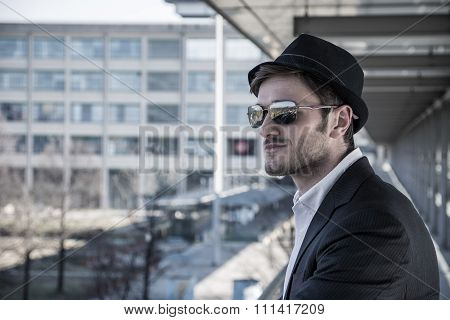 Man Wearing Hat and Looking Out Window