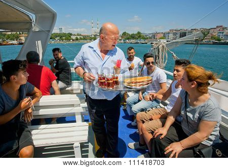 Senior Waiter From Restaurant Of The Ferry Serving Cold Drinks And Tea