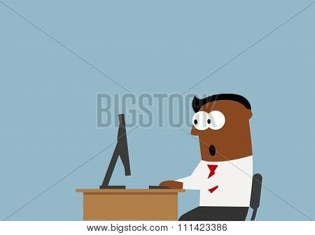 Surprised businessman goggled eyes at the monitor