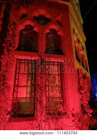 House Windows Lit At Night
