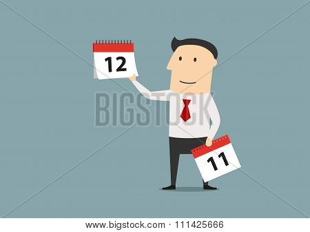 Businessman woth calendar of last month of year