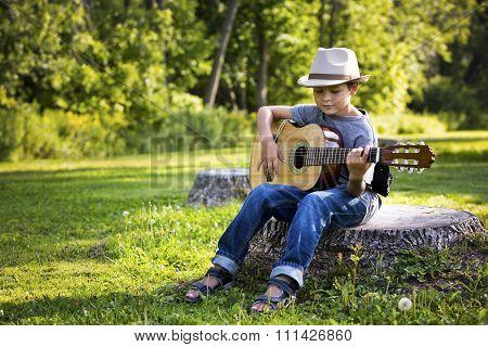 Portrait Of A Little Boy With Guitar