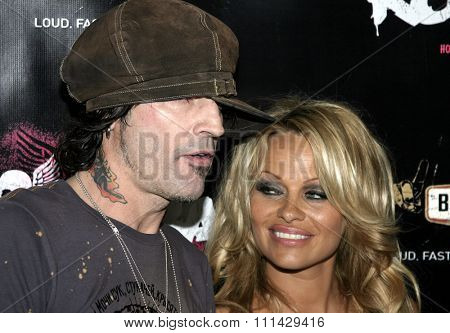 June 30 2005. Tommy Lee and Pamela Anderson attend at the Rokbar Hollywood Grand Opening Party in Hollywood, California.