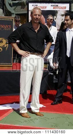 09/06/2006 - Hollywood - Kevin Costner attends the Kevin Costner Hand and Footprints Ceremony held at the Grauman's Chinese Theater in Hollywood, California, United States.