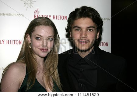 Amanda Seyfried and Emile Hirsch at the 55th Annual Ace Eddie Awards held at the Beverly Hilton Hotel in Beverly Hills, California United States on February 20, 2005.