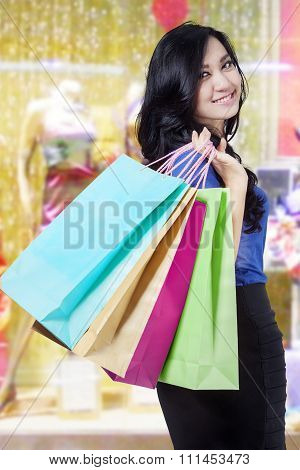 Beautiful Buyer Carrying Shopping Bags