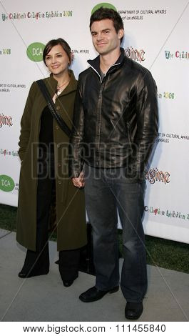 Daniel Gillies and wife Rachael Leigh Cook attend the opening of