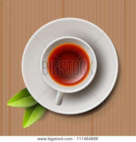 Cup of black tea, top view on cardboard