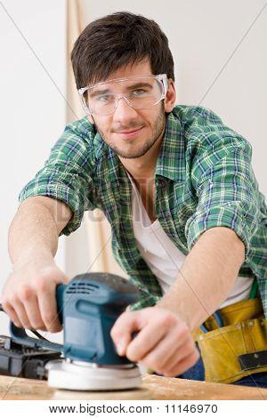 Home Improvement - Handyman Sanding Wooden Floor