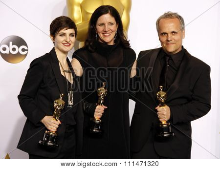 Dirk Wilutzky, Laura Poitras and Mathilde Bonnefoy at the 87th Annual Academy Awards Press Room held at the Loews Hollywood Hotel in Hollywood on February 22, 2015.