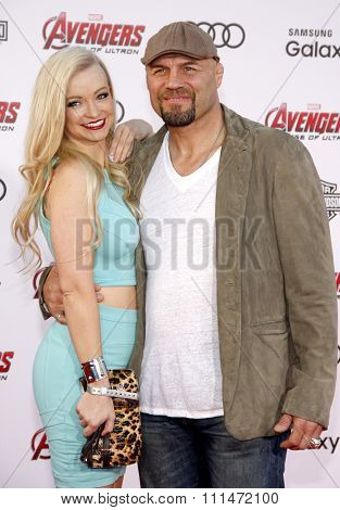 Mindy Robinson and Randy Couture at the World premiere of Marvel's 'Avengers: Age Of Ultron' held at the Dolby Theatre in Hollywood, USA on April 13, 2015.
