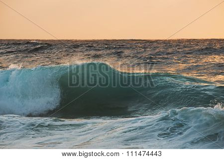 Single Wave Close Up On Sunrise