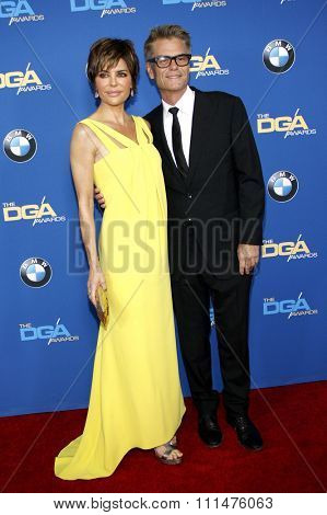 Lisa Rinna and Harry Hamlin at the 66th Annual Directors Guild Of America Awards held at the Hyatt Regency Century Plaza Hotel in Los Angeles on January 25, 2014 in Los Angeles, California.