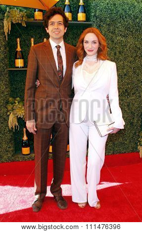 Christina Hendricks and Geoffrey Arend at the Fifth Annual Veuve Clicquot Polo Classic held at the Will Rogers State Historic Park in Los Angeles on October 11, 2014 in Los Angeles, California.