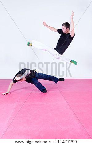 Two Men Exercising Capoeira