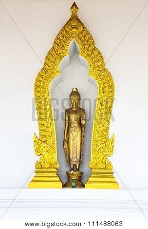 SURAT THANI, THAILAND - APRIL 21: Buddha Statue in golden arch frame on April 21, 2013 in Surat Thani.