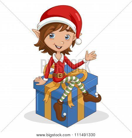 Christmas elf sitting on gift.