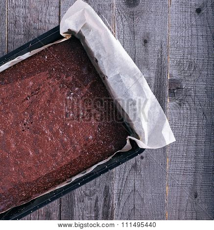 Chocolate brownie in pan from oven