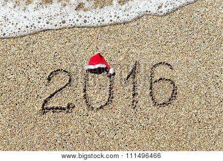 Year 2016 Caption With Christmas Hat On Sandy Sea Beach