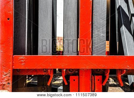 Red Metal Abstract: Belted Lift System