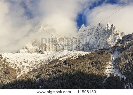 Mountain summits in clouds and fog