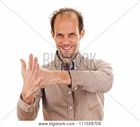 Exited young man kicks clenched fist arm