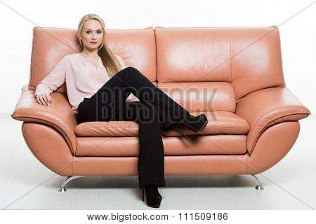 Elegant beautiful woman sitting on a couch a leather. isolated on white. Training managers. sales ag