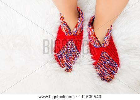 Woman's feet in woolen socks