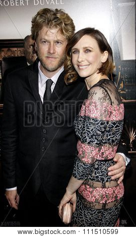 Renn Hawkey and Vera Farmiga at the Los Angeles premiere of 'The Judge' held at the AMPAS Samuel Goldwyn Theater in Los Angeles on October 1, 2014.