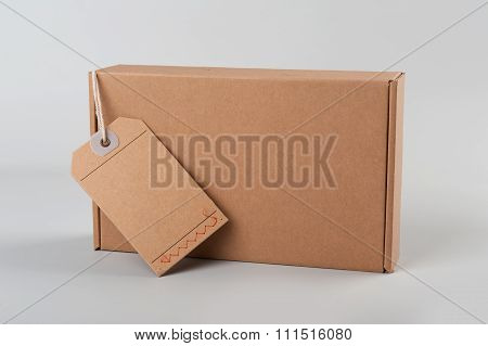 Parcel. Cardboard Box With Blank Tag