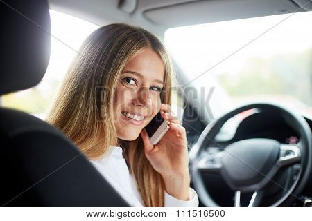 Young Business Woman Sitting In Car And Call