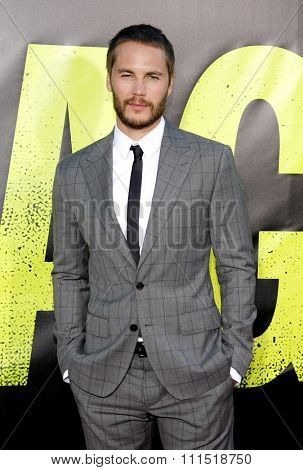 Taylor Kitsch at the Los Angeles premiere of 'Savages