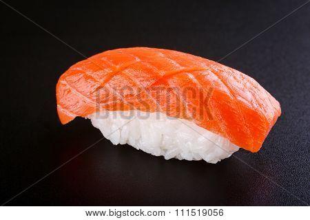 Nigiri Sushi With Salmon On Black Background