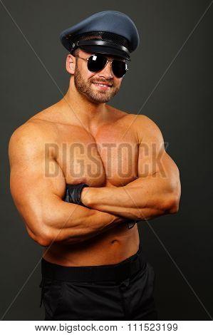 Muscular smiling policeman