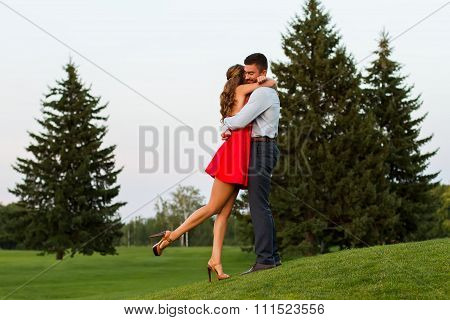 Guy hugging his girlfriend.