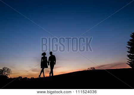 Lovers on sunset background.