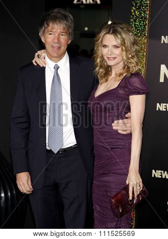 David E. Kelley and Michelle Pfeiffer at the Los Angeles premiere of 'New Year's Eve' held at the Grauman's Chinese Theatre in Hollywood on December 5, 2011.