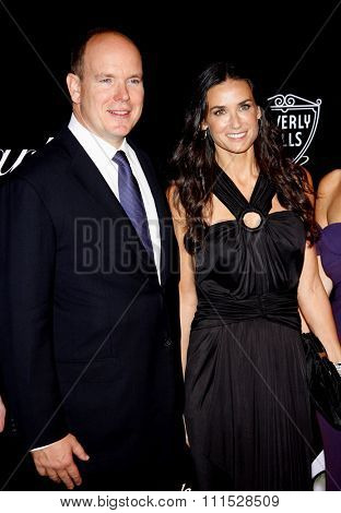 Prince Albert II of Monaco and Demi Moore at the Rodeo Drive Walk of Style Award honoring Princess Grace Kelly of Monaco and Cartier in Beverly Hills on October 22, 2009.