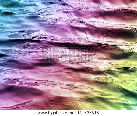 Beautiful waters with soft ripples on surface in Rainbow colors