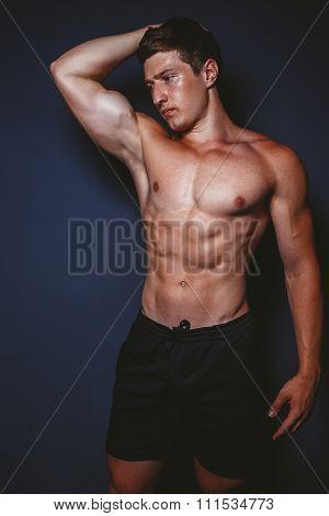 Man showing sports figure