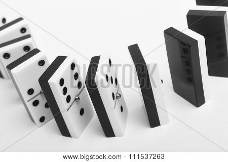 Domino Game With Pieces Over A White Background. Black, White