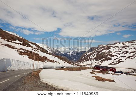 Snowy Mountain Road And The Red Houses