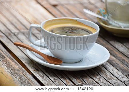 One Full Cup Of Americano Coffee On Bamboo Table