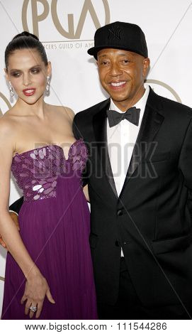 Russell Simmons and Hana Nitsche at the 24th Annual Producers Guild Awards held at the Beverly Hilton Hotel in Beverly Hills, USA on January 26, 2013.