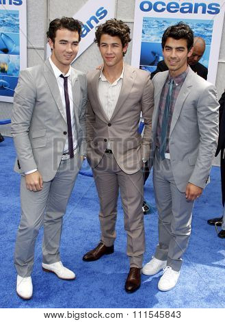 Nick Jonas, Kevin Jonas and Joe Jonas of The Jonas Brothers at the Los Angeles premiere of 'Oceans' held at the El Capitan Theater in Hollywood, USA on April 17, 2010.