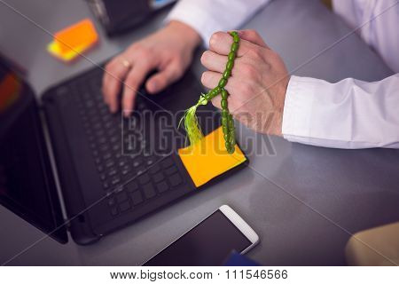 Arabian business man working on laptop at his office. Close-up hand on the keyboard