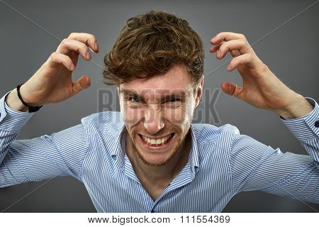 Businessman Yelling Over Gray Background