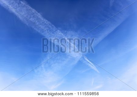 Aircraft Crossed Tracks In A Blue Sky
